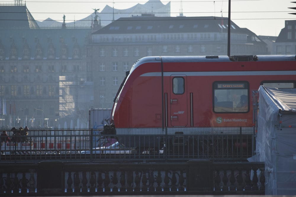 red and white train on rail during daytime