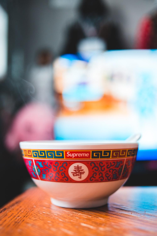 white and orange ceramic bowl