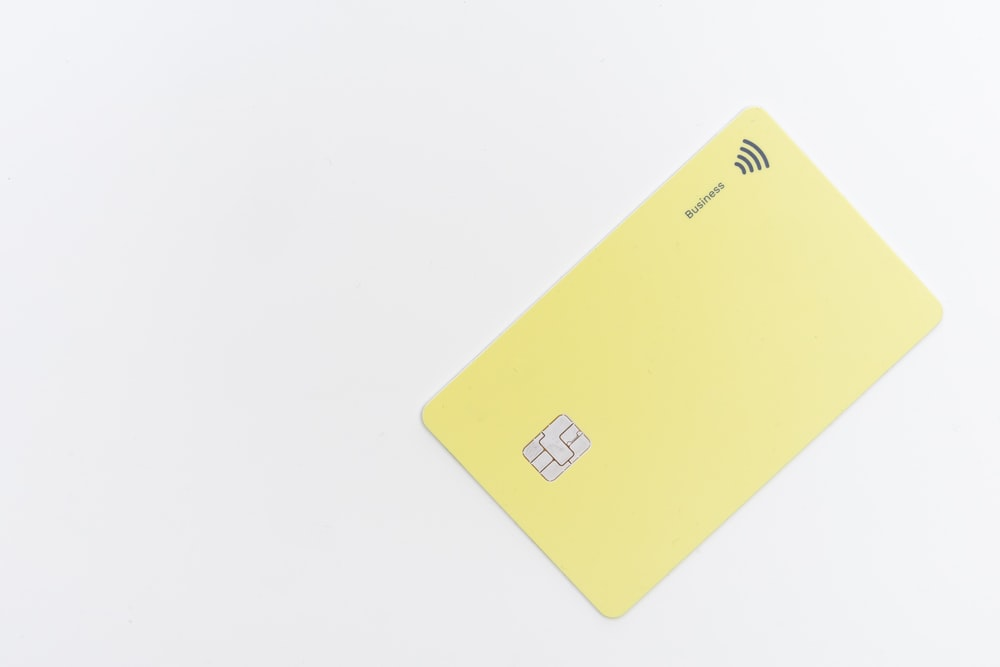yellow square card on white surface