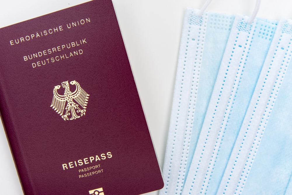 red passport on white table