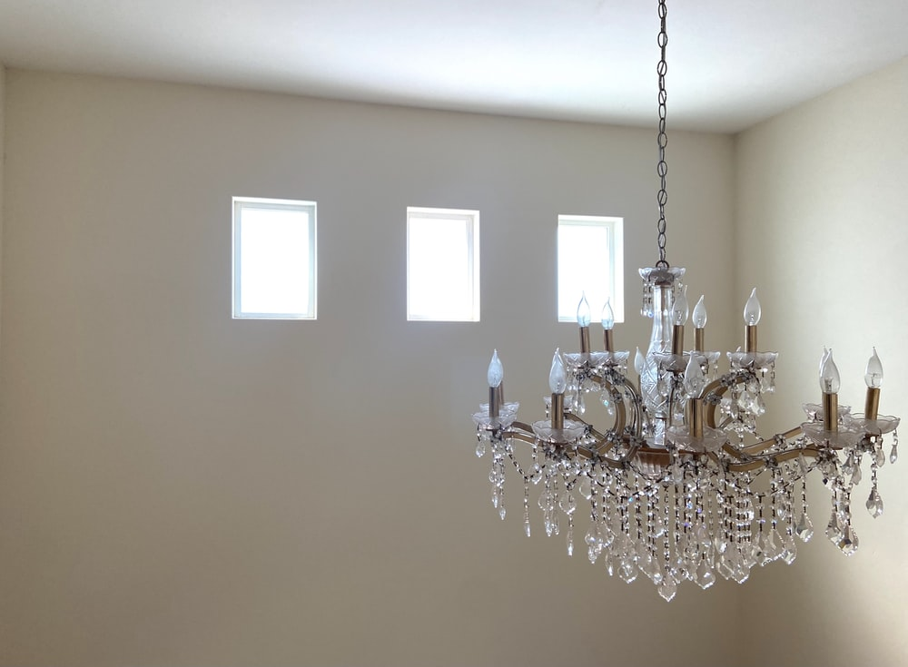 silver and crystal chandelier on white ceiling
