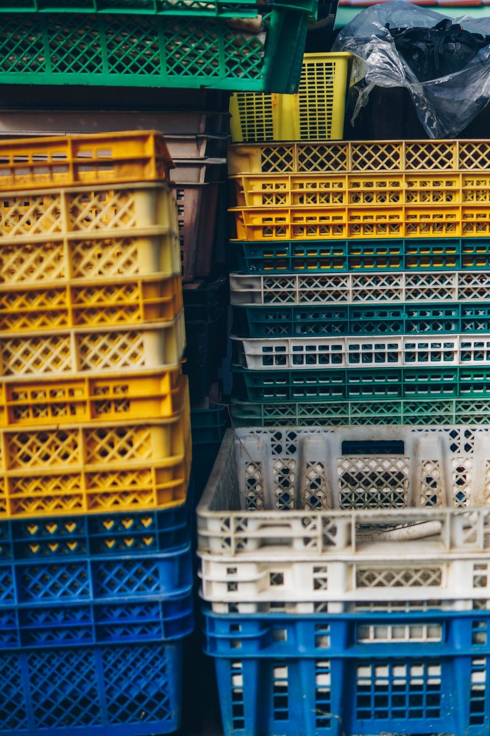 yellow and blue plastic crates