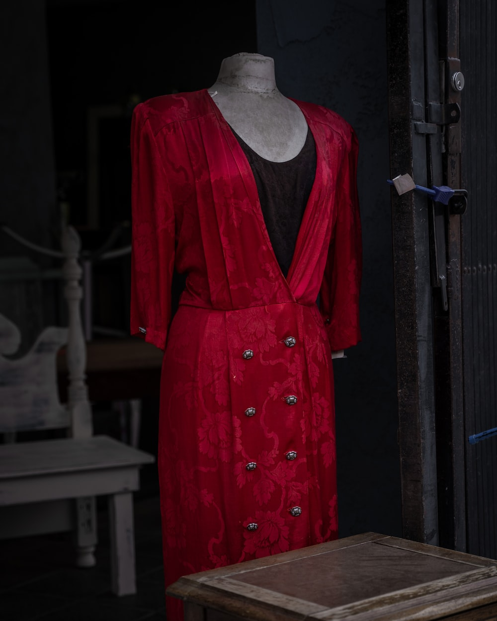 woman in red long sleeve dress standing