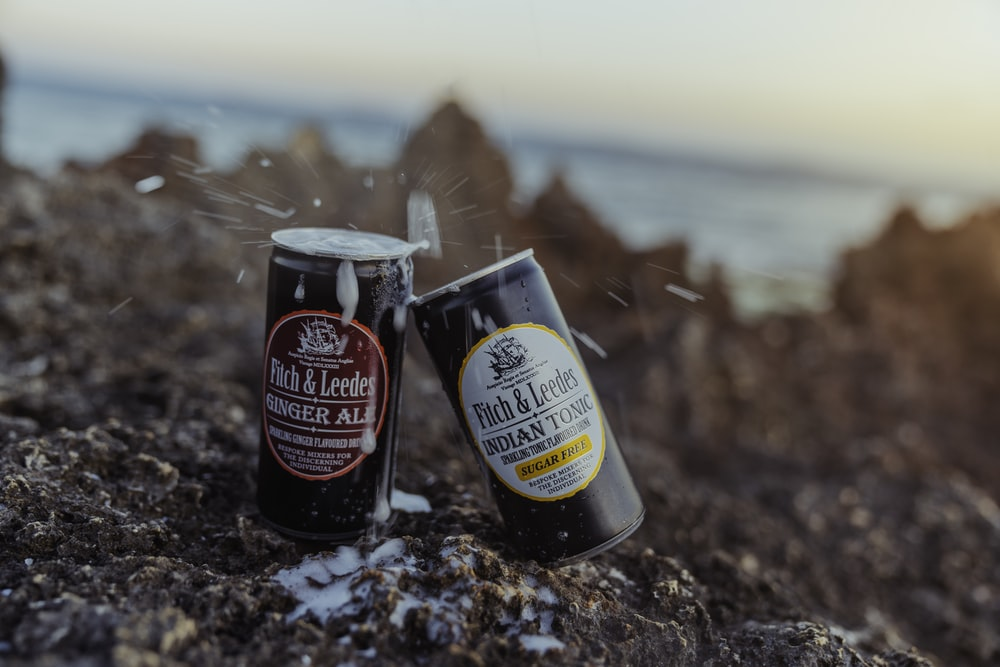 black and white can on brown and black soil
