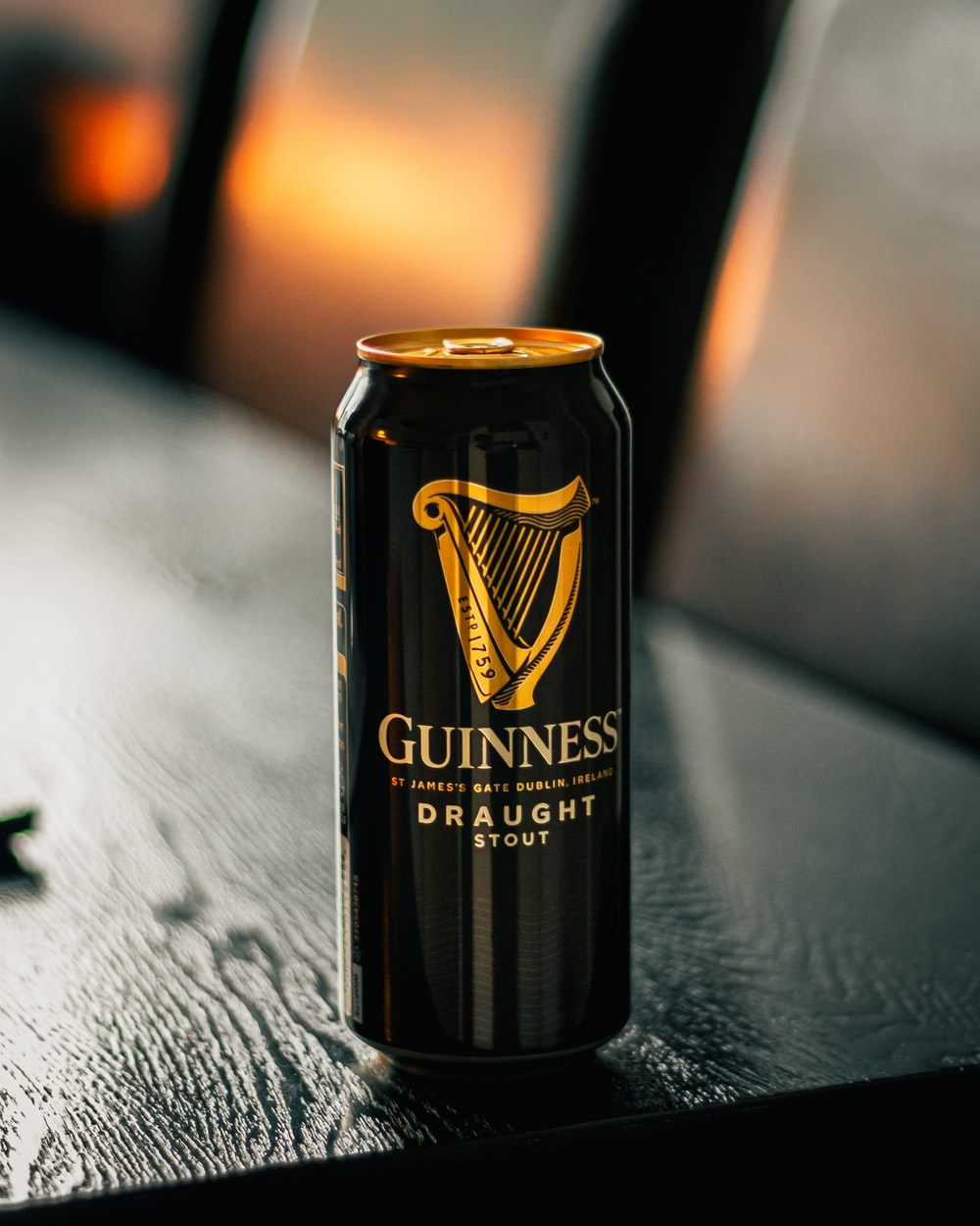 black and gold can on black table