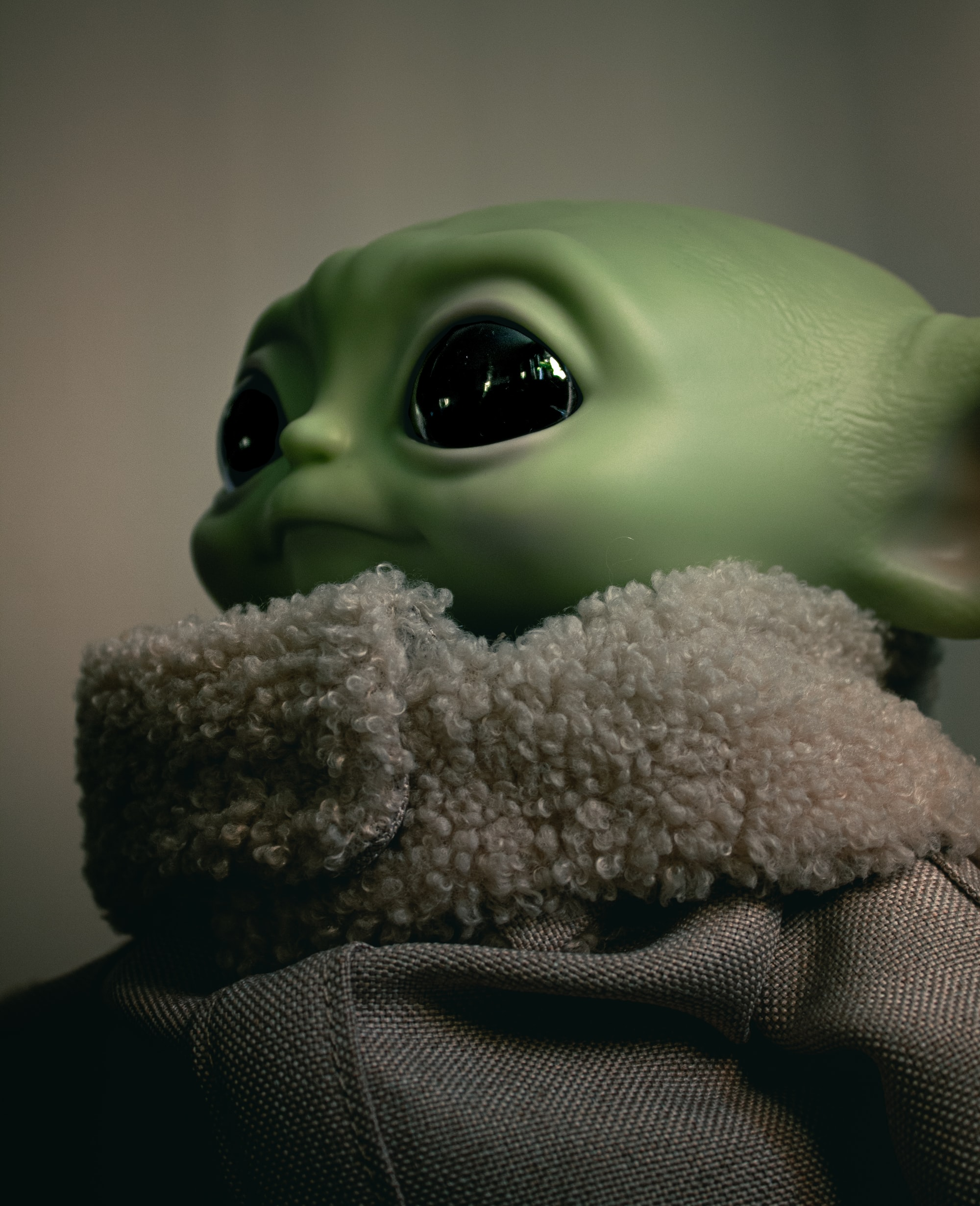 Close-up image of Baby Yoda (Grogu) toy from Star Wars: The Mandalorian.