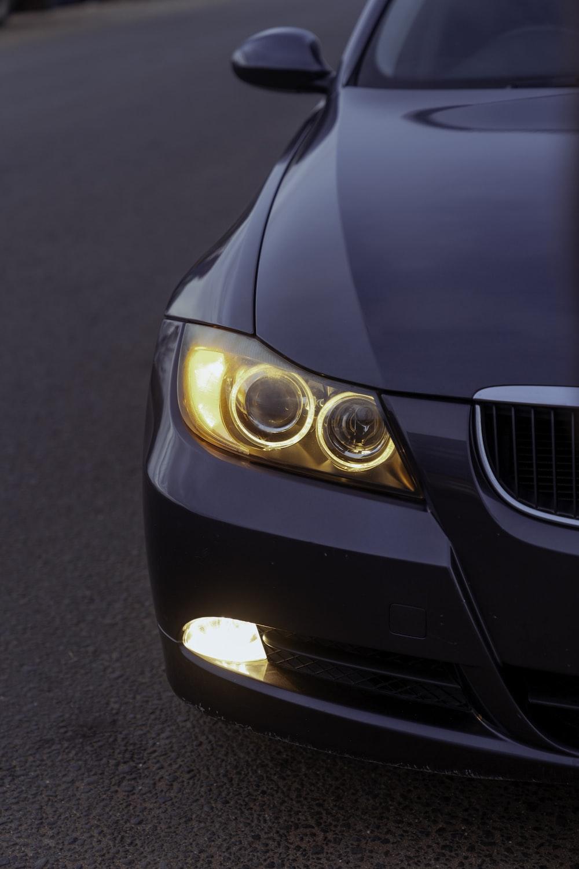 black bmw car on road