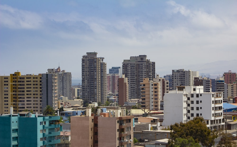 brown and white concrete buildings during daytime
