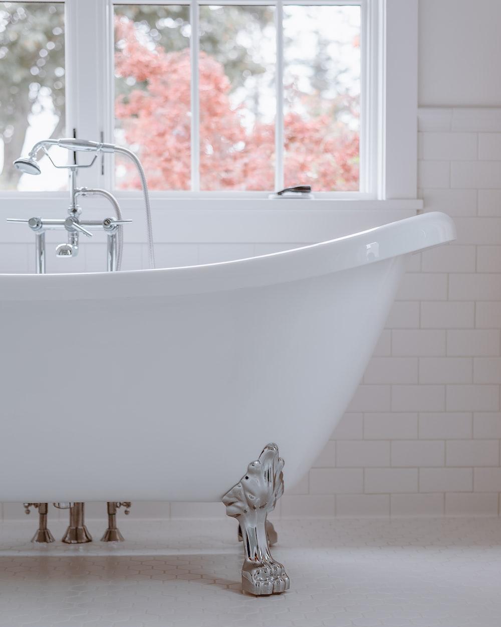 white bathtub with white bathtub