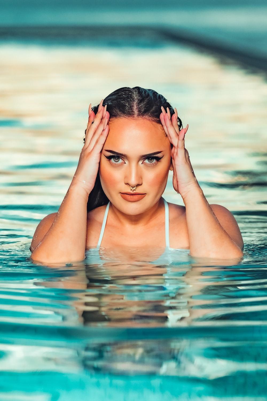 woman in white bikini top on water