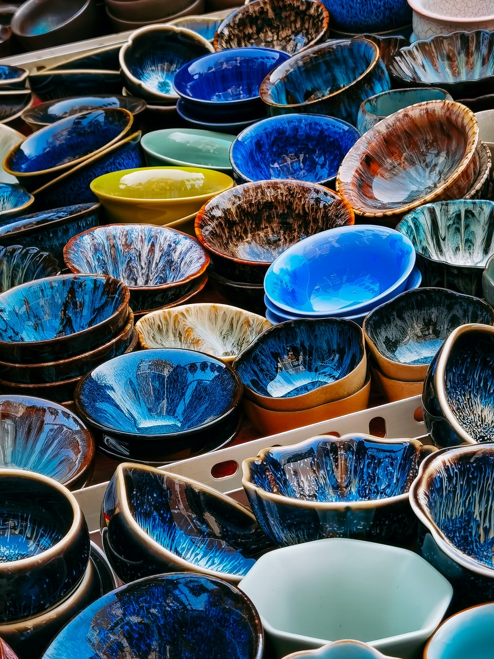 blue and yellow plastic bowls