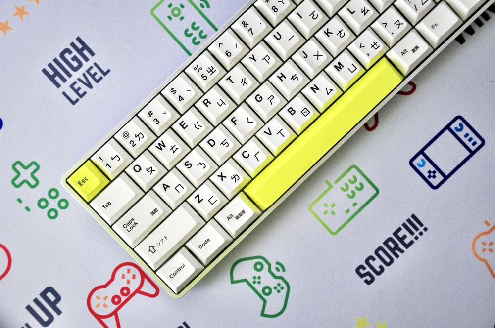 yellow and white keyboard on blue and white surface