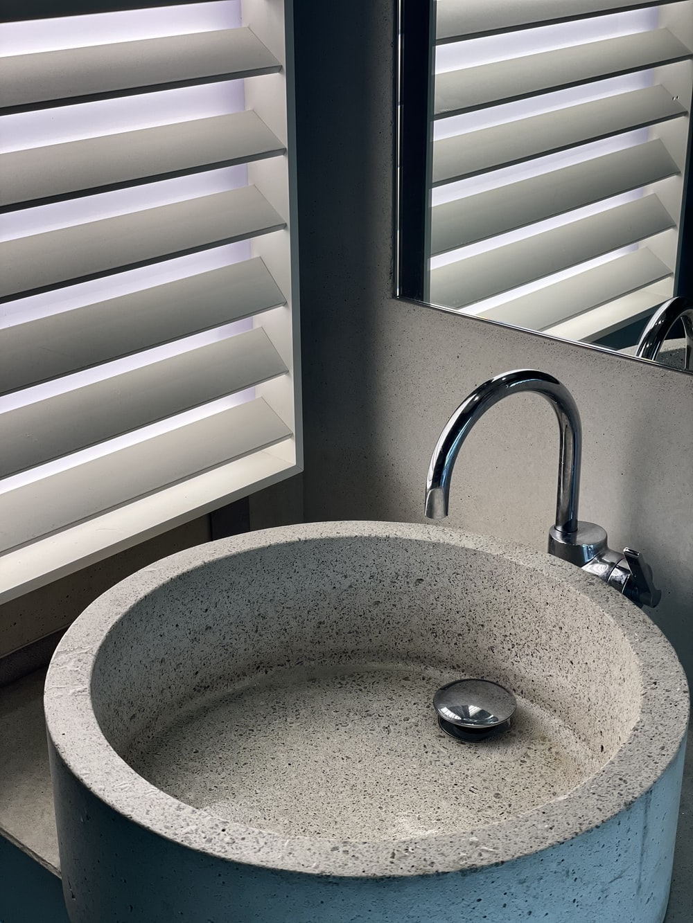 stainless steel faucet near window blinds