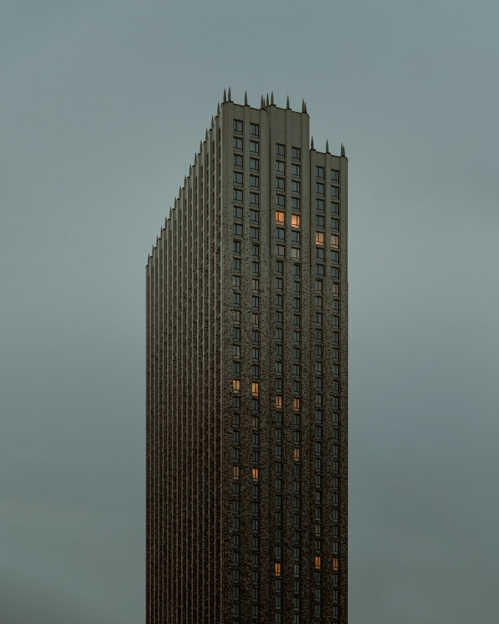 black high rise building under gray sky