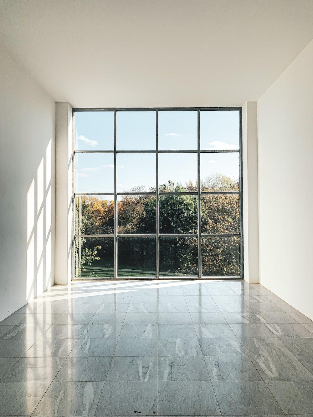 white framed glass window during daytime