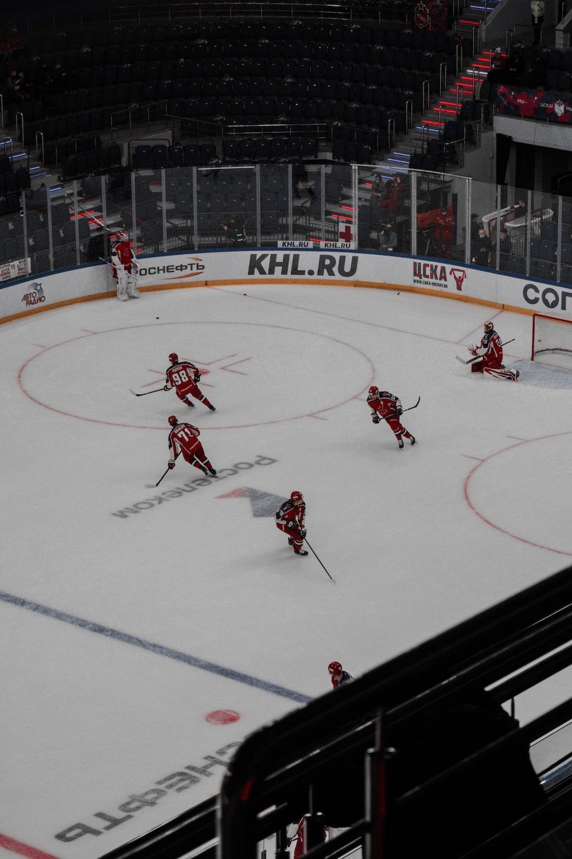 people playing ice hockey on ice field