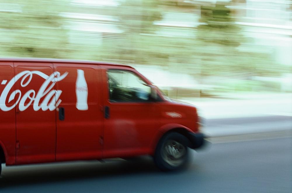 red van on road during daytime