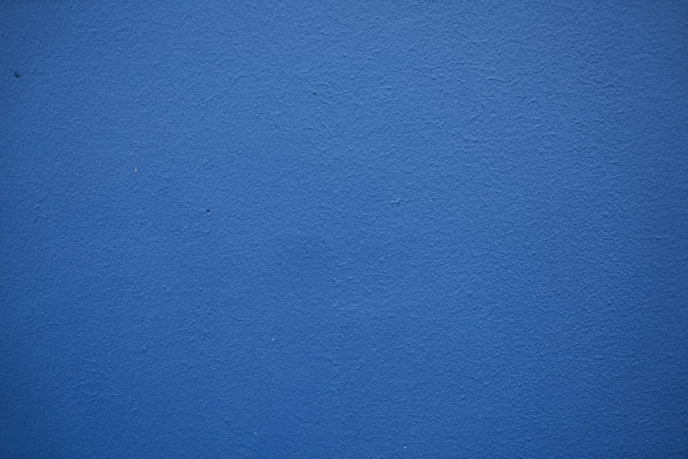 blue painted wall with white paint