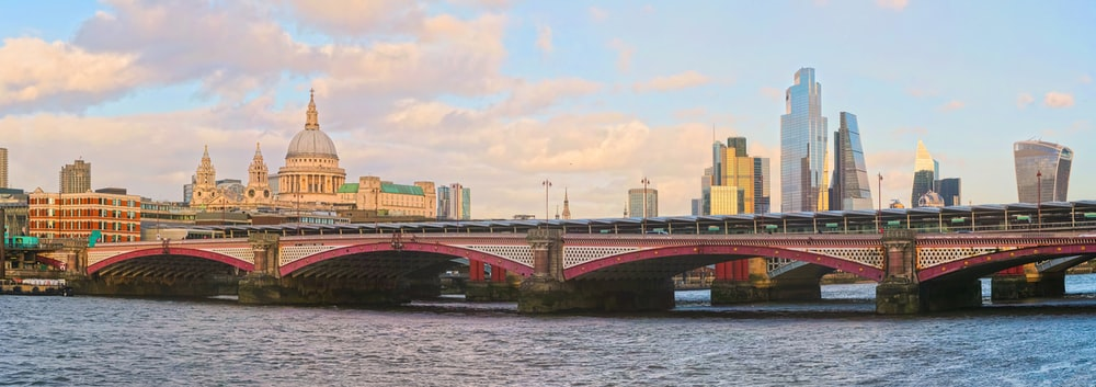 brown bridge over river during daytime