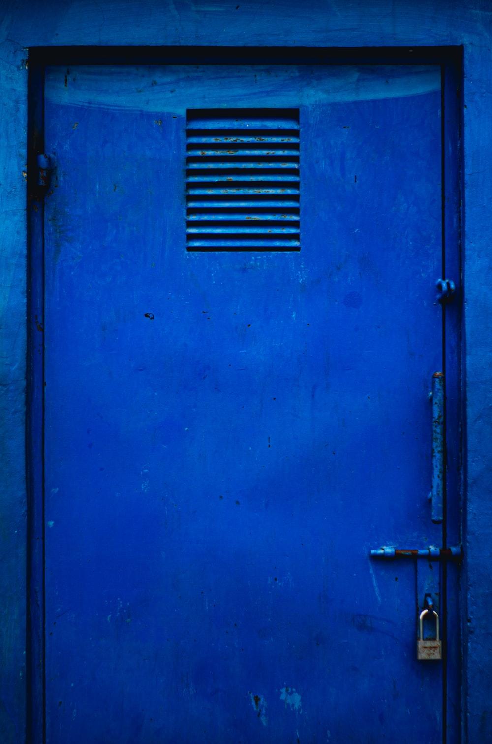 blue steel door with white steel door handle
