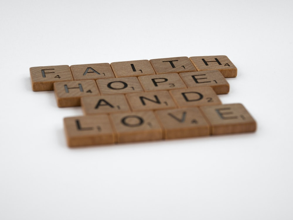 brown wooden puzzle blocks on white surface