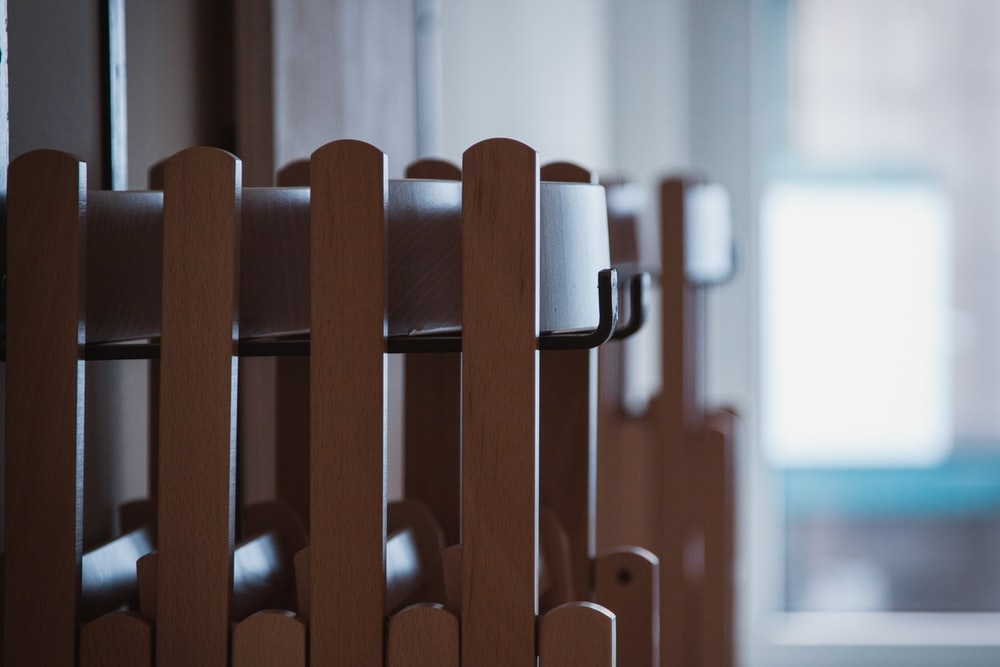 brown wooden chairs in room