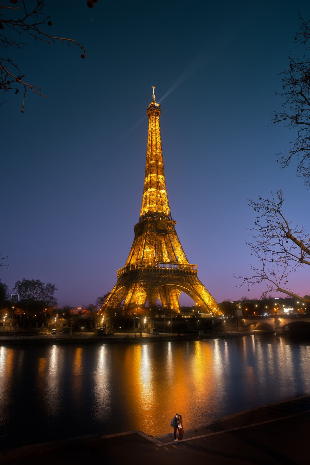 eiffel tower near body of water during night time