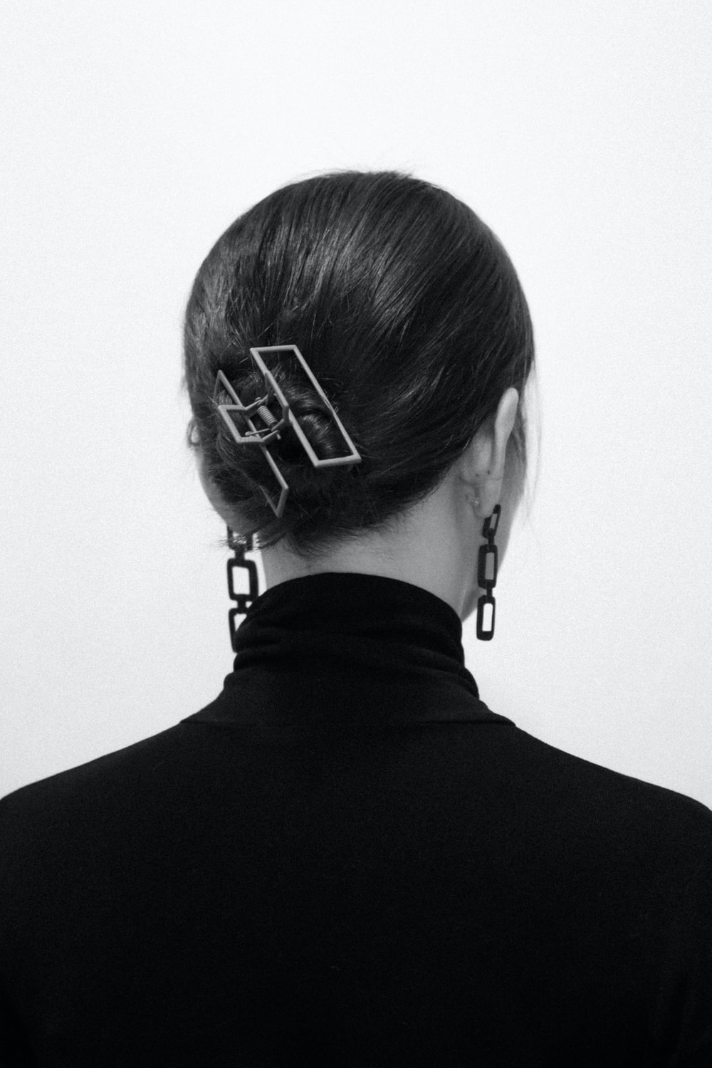 woman in black shirt with hair clip