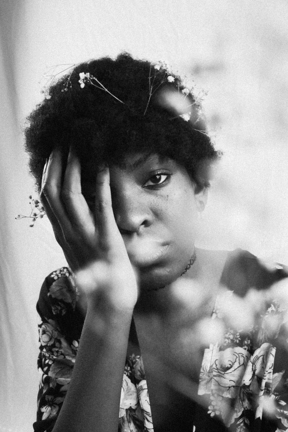 grayscale photo of woman with floral headdress