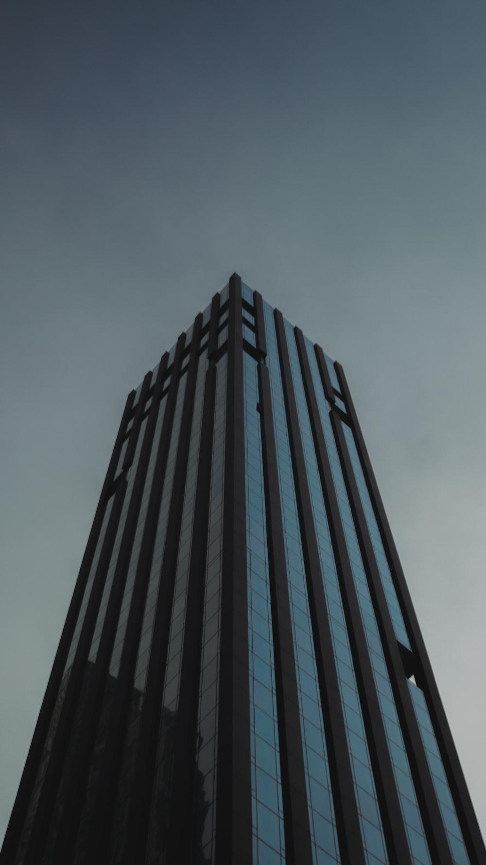 black high rise building under white sky