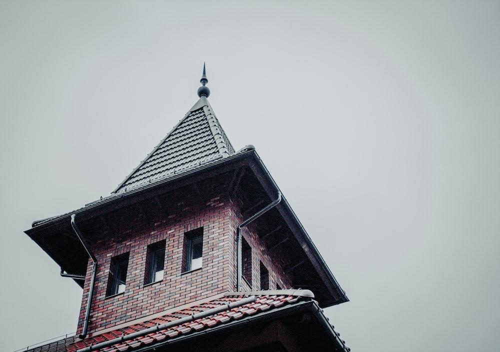 red brick building under white sky