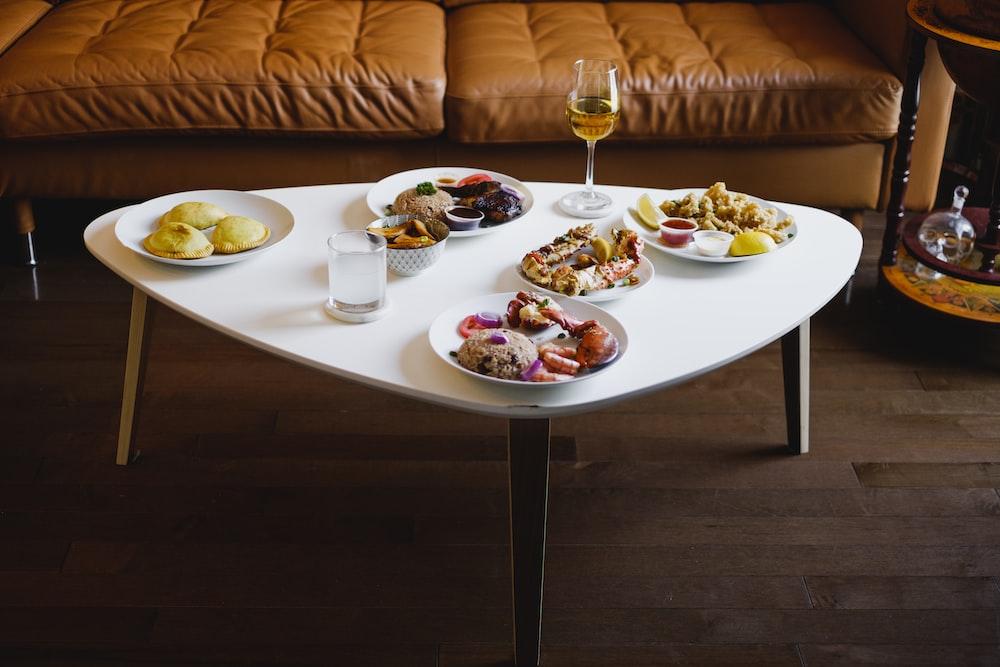 white ceramic plate on white wooden table