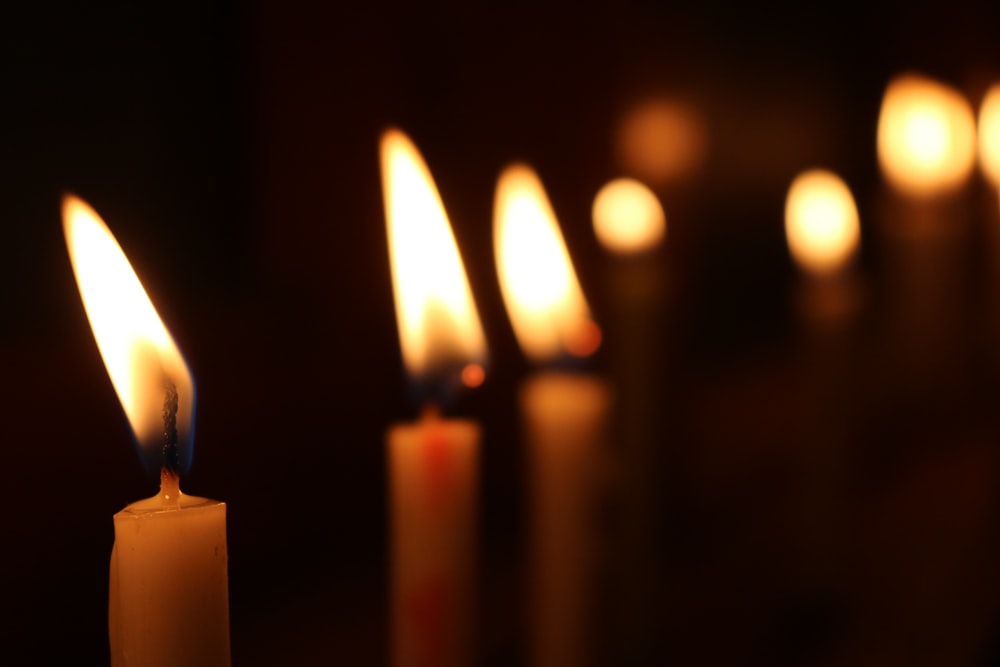 white candles on black background