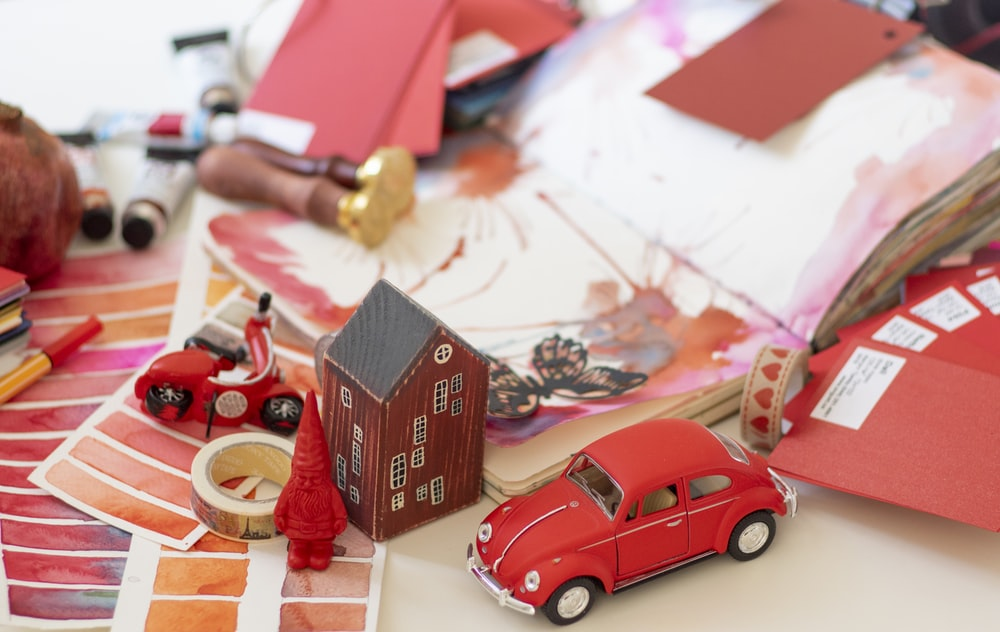 red and white car scale model
