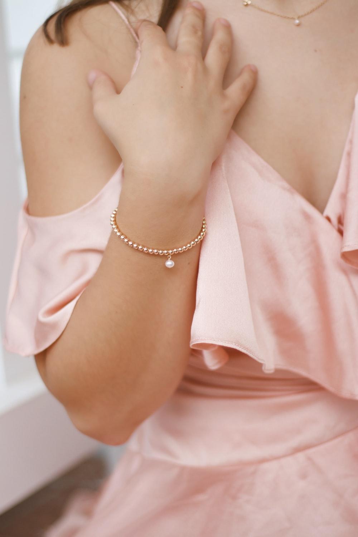 woman in pink dress wearing silver bracelet