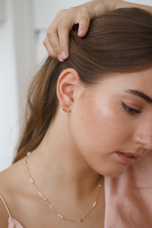 woman in white pearl earrings