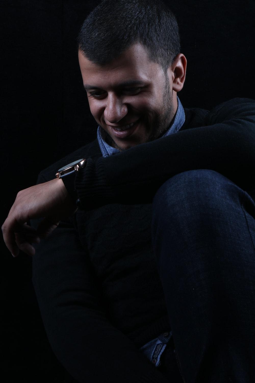 man in black long sleeve shirt and black vest