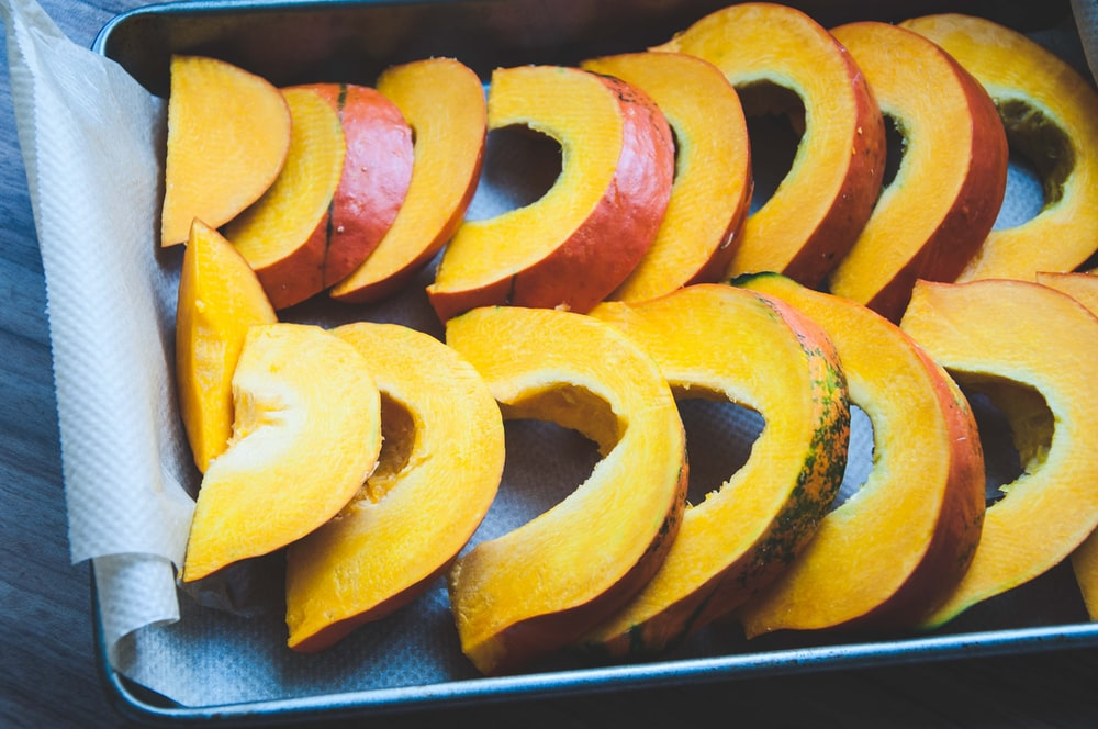 sliced fruit on black tray