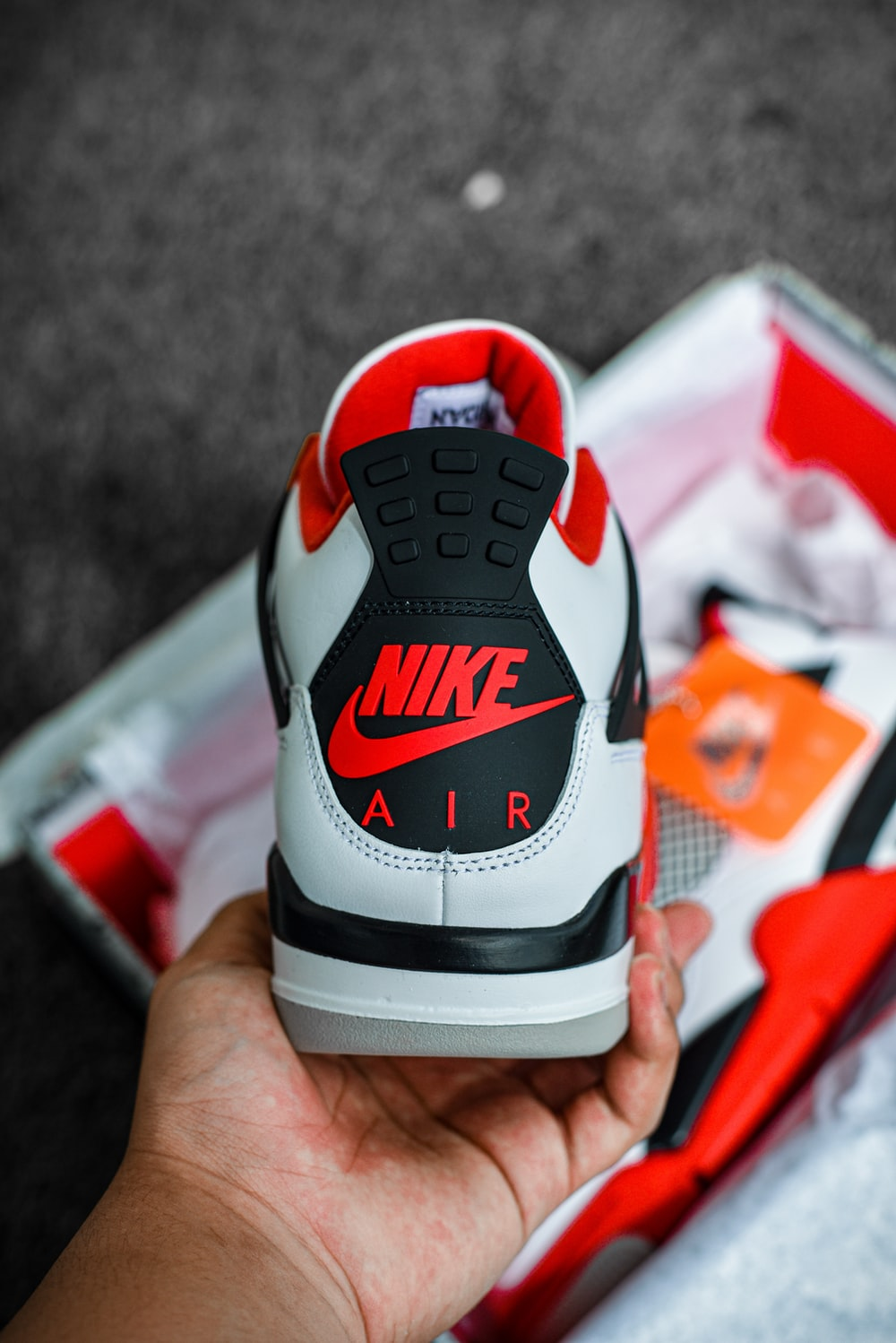 white red and black nike shoe
