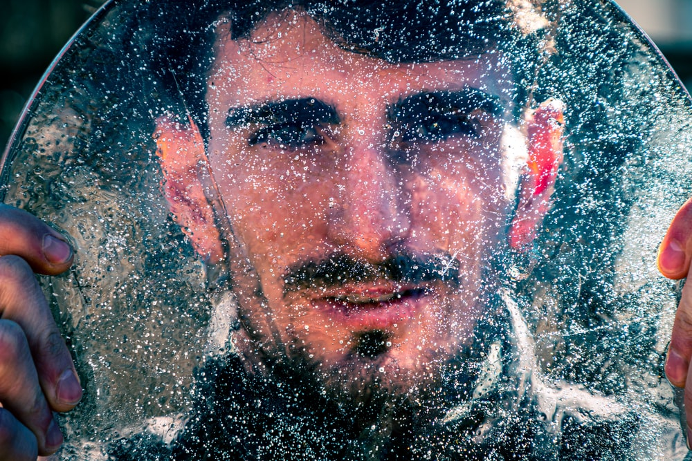mans face on water