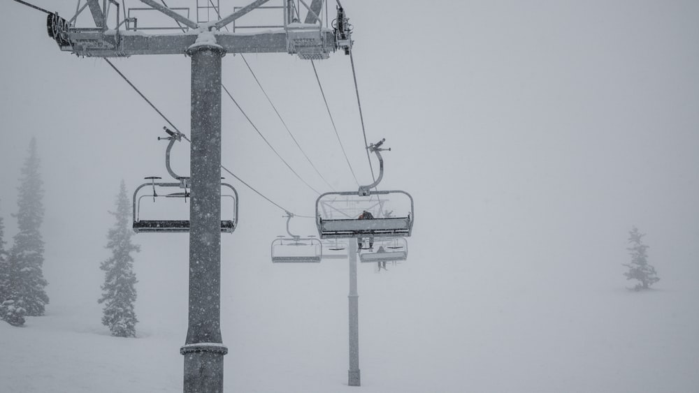 black and white cable car under white sky