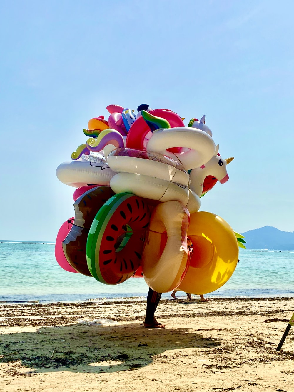 white blue and red inflatable inflatable balloon on beach shore during daytime