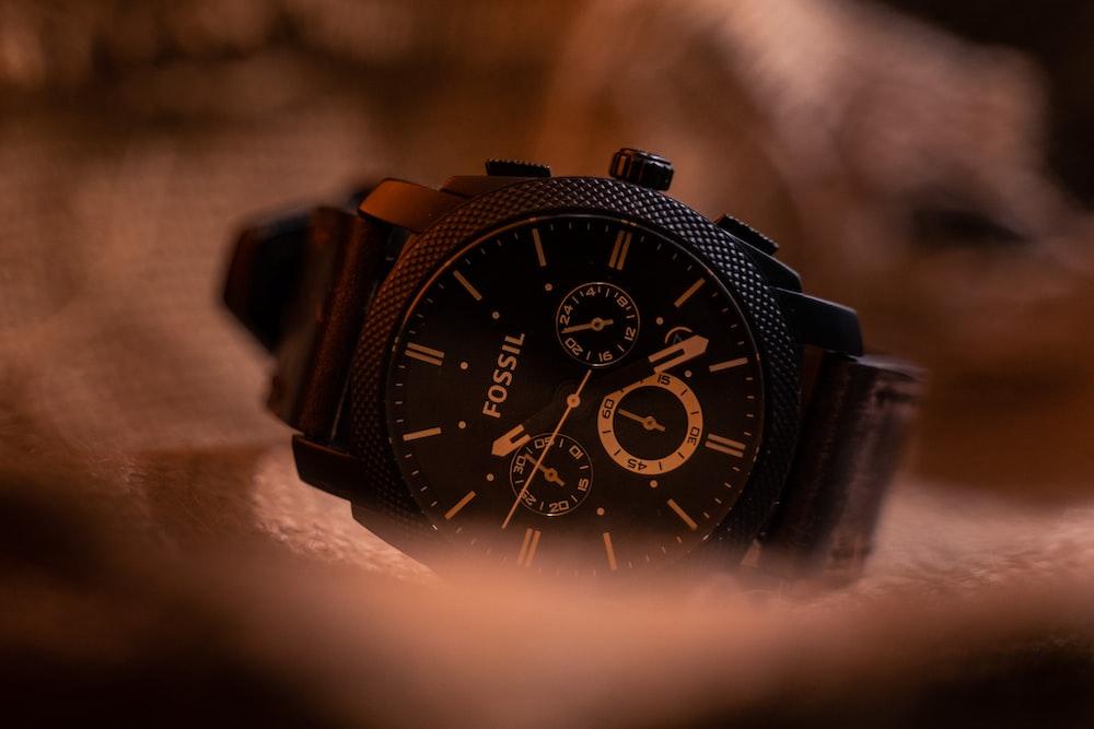 black chronograph watch at 10 00