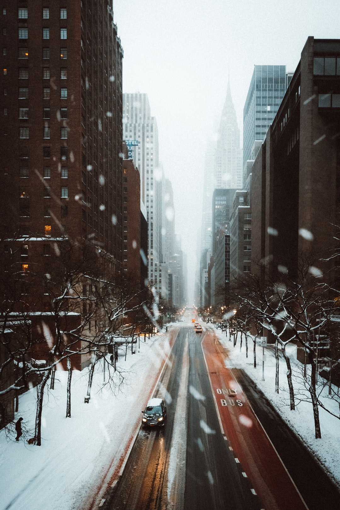 road between high rise buildings during winter