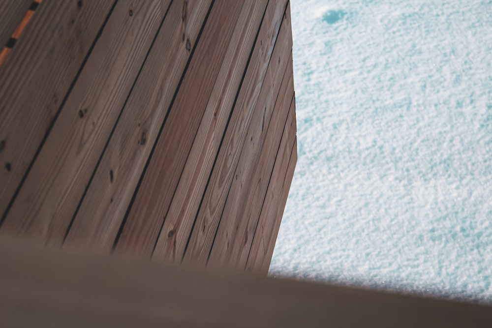 white and blue textile on brown wooden surface
