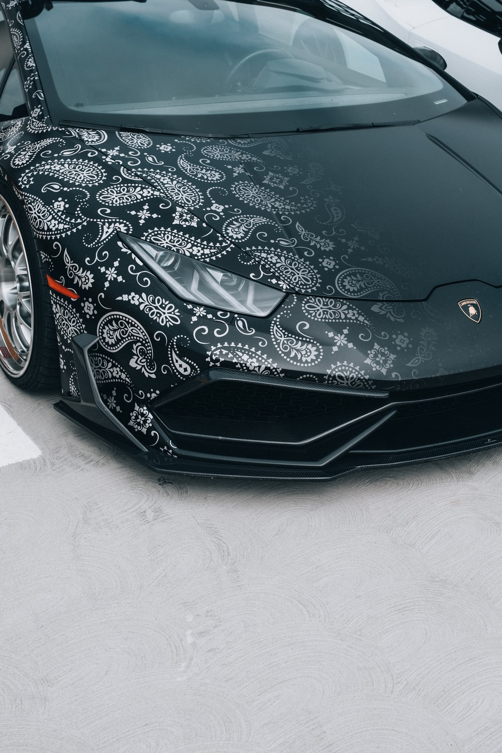 black ferrari car on white floor