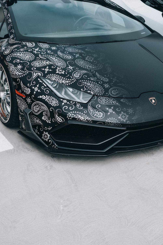 black ferrari car on white floor