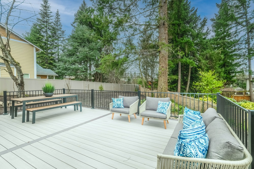 white wooden bench on wooden deck