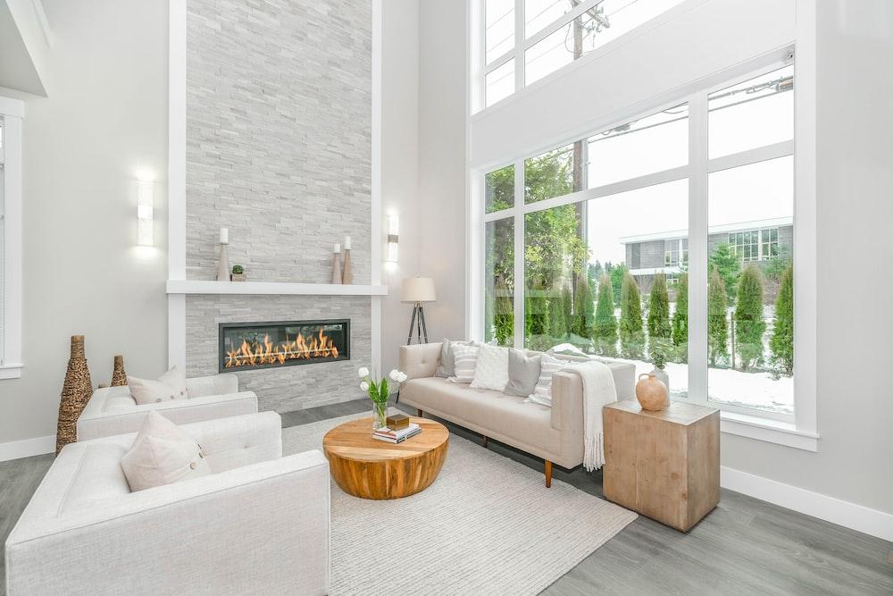 white couch near glass window