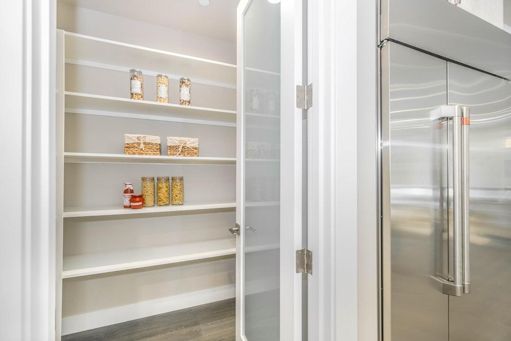 white wooden framed glass cabinet